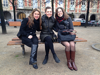 PFMP students sitting on a bench in a Parisian park
